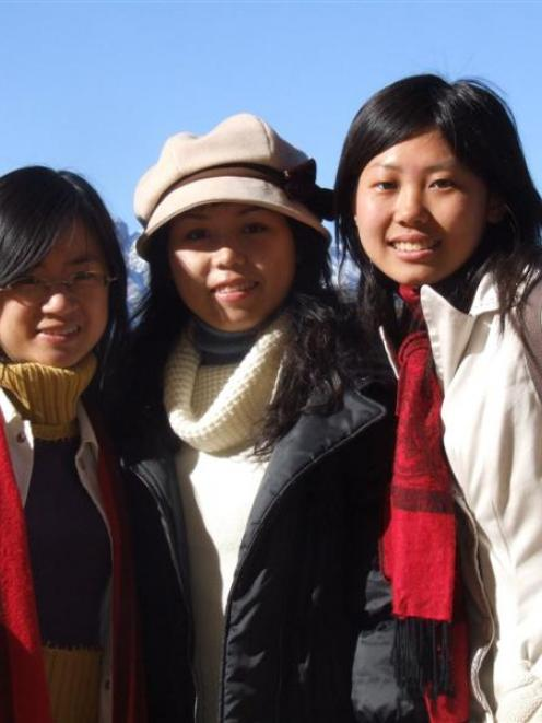 Chinese students (from left) Carol Mengxi Lin, Rachel Yunqi Zeng and Zoe Zuo stroll through...