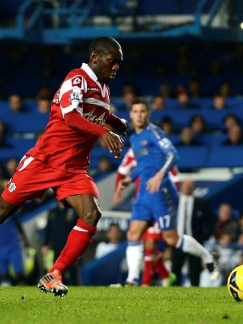 QPR's Shaun Wright-Phillips shoots to score against Chelsea during their English Premier League...
