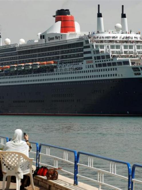 Queen Mary 2, the world's largest ocean liner, crosses the Suez Canal in Ismailia. Posted between...