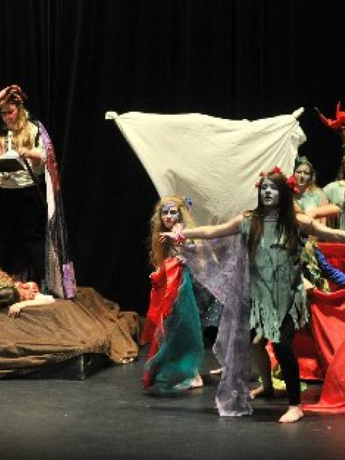 Queen's High School pupils perform a scene from The Tempest at the opening of the University of...