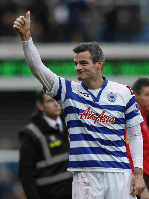Queens Park Rangers' Ryan Nelsen salutes the fans.   REUTERS/Eddie Keogh
