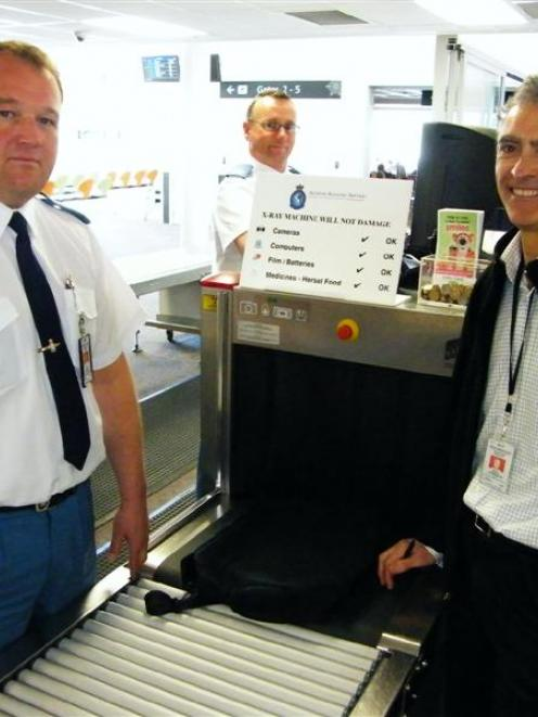 Queenstown Airport aviation security officers Athol Murray (left) and Paul Franklin (centre), and...