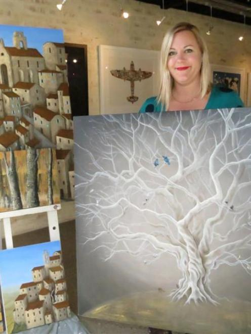 Queenstown artist Rachael Errington with her piece, The Peaceful Place, which will be offered by...