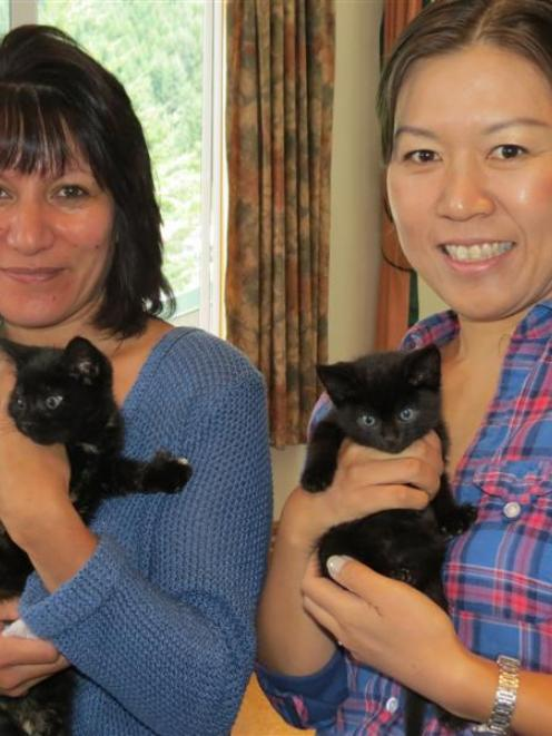 Queenstown Cat Rescue trustee and co-founder Ruth de Reus (left) and trustee Mayumi Rowcroft hold...