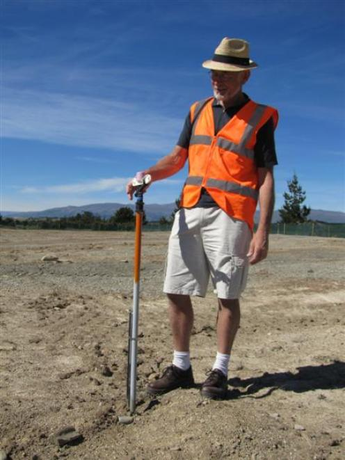 Queenstown Lakes District Council capital works manager Ken Gousmett inspects a  spray nozzle...