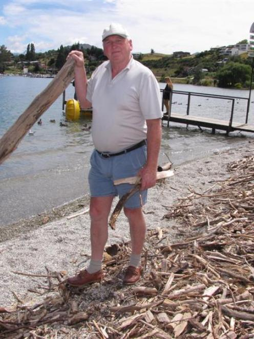 Queenstown Lakes harbourmaster Marty Black stands on the shore of Lake Wanaka yesterday with...