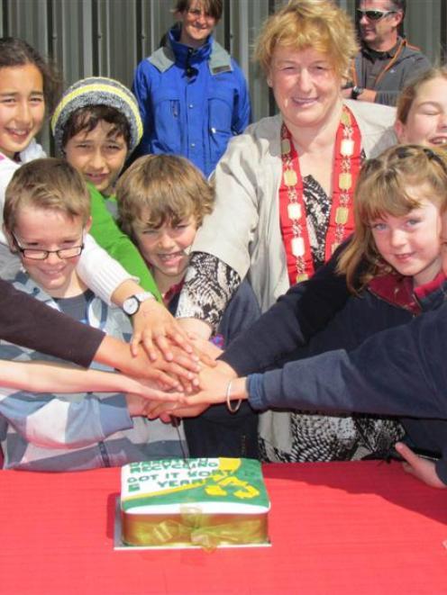 Queenstown Lakes  Mayor Vanessa van Uden and local schoolchildren cut a cake celebrating five...