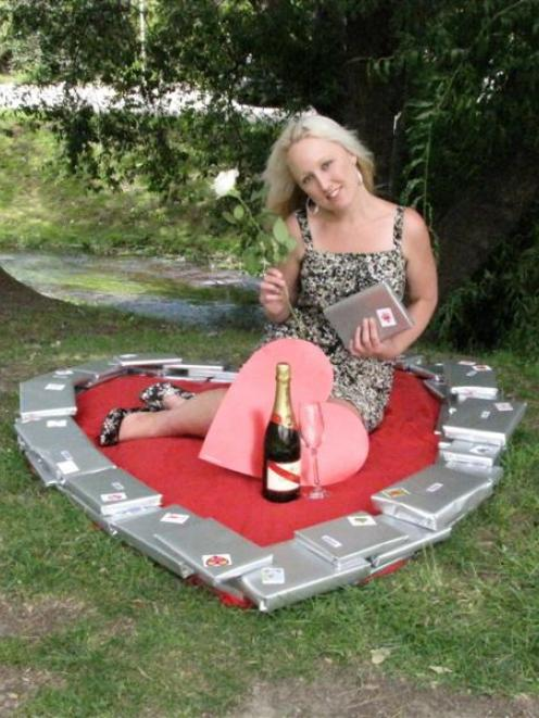 Queenstown librarian Annie Wilcox is surrounded by mystery Blind Date with a Book titles. The...