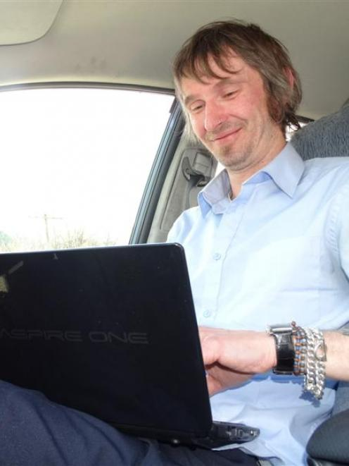 Queenstown novelist and taxi driver Jon Whitfield adds to his latest novel. Photo by Guy Williams.