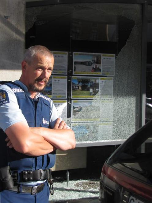 Queenstown Police Constable Terry Erseg was called to a mystery broken window on Athol St, on...