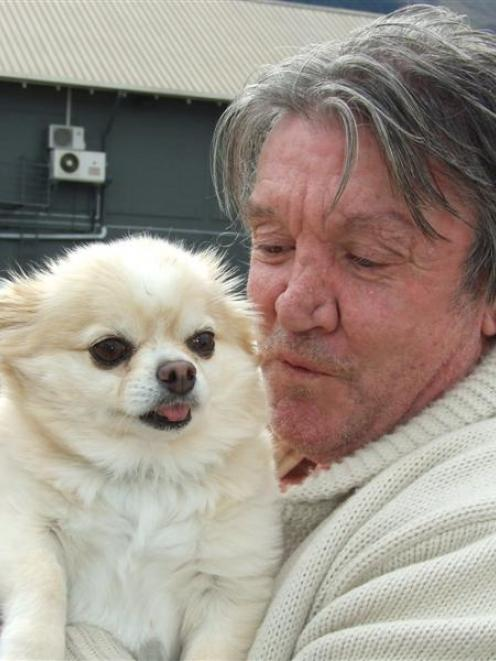 Queenstown's David Simpson, with his pet chihuahua Buster, wants the Government to subsidise vet...