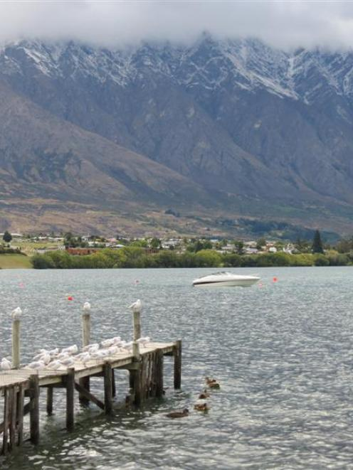 Queenstown woke to a dusting of snow on the peaks of the Wakatipu basin, including the...