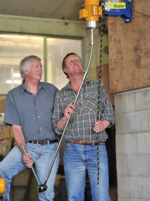 R. J. Wilson (left), from Shearing Services, and P & W Engineering general manager Bob Adams...