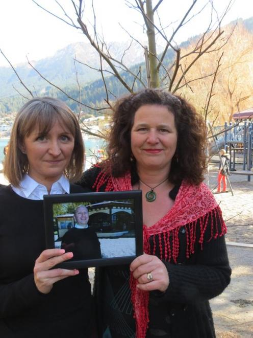 Rachel Rose (left) and Belinda Crichton stand in front of a liquidambar planted in Queenstown Bay...