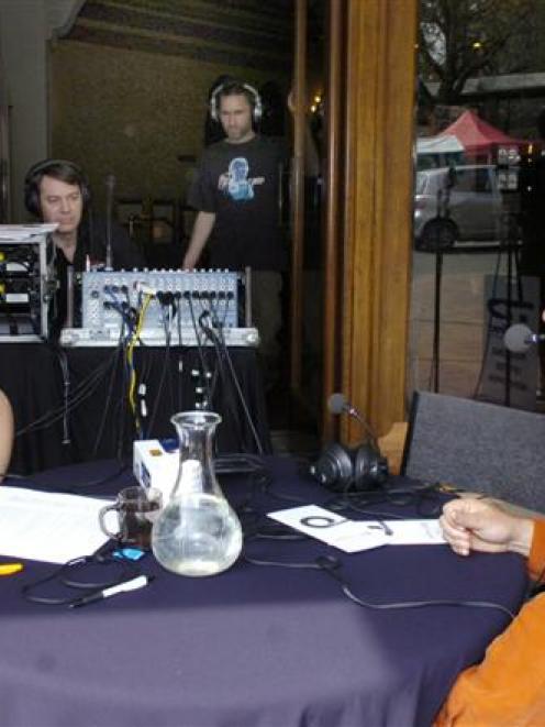 Radio New Zealand announcer Eva Radich interviews musician Trevor Coleman outside the Regent...