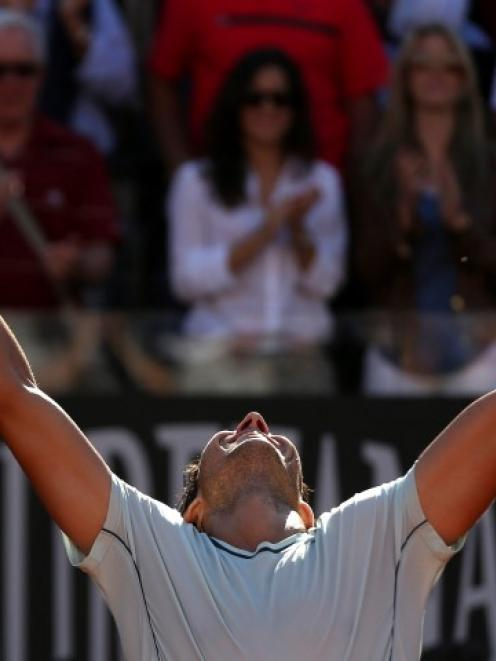 Rafael Nadal of Spain celebrates after winning the men's singles final match against Roger...