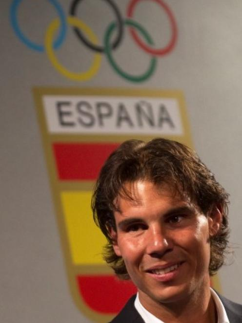 Rafael Nadal, who was to have been the official Spanish flag bearer at the London Olympics, at a...