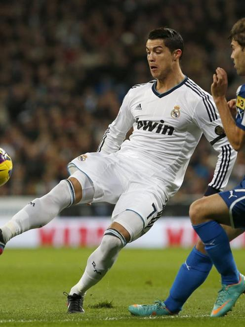 Real Madrid's Cristiano Ronaldo will face his old club Manchester United in the Champions League....