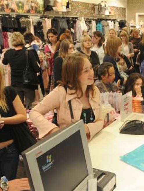 Rebecca English serves customers at Glassons on Saturday. Photo by Peter McIntosh.