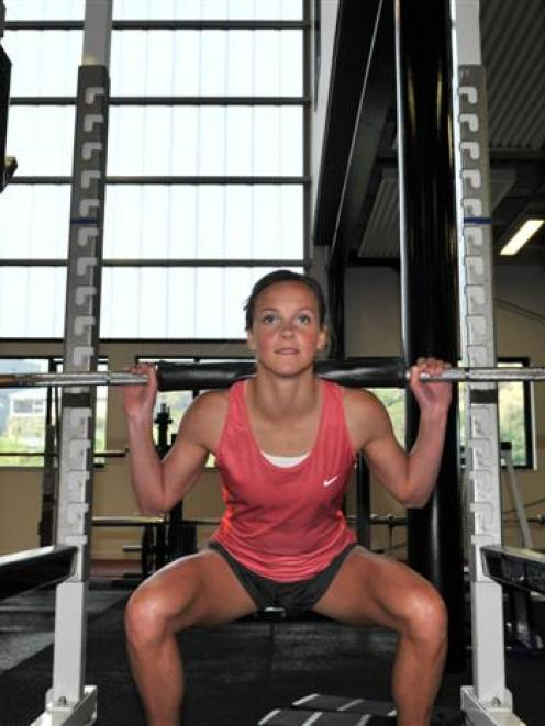 Rebekah Greene lifting weights at the High Performance Sport New Zealand gymnasium yesterday....