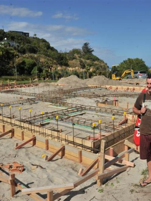 Rebuild committee convener Scott Weatherall on the build site at the new Brighton Surf Life...