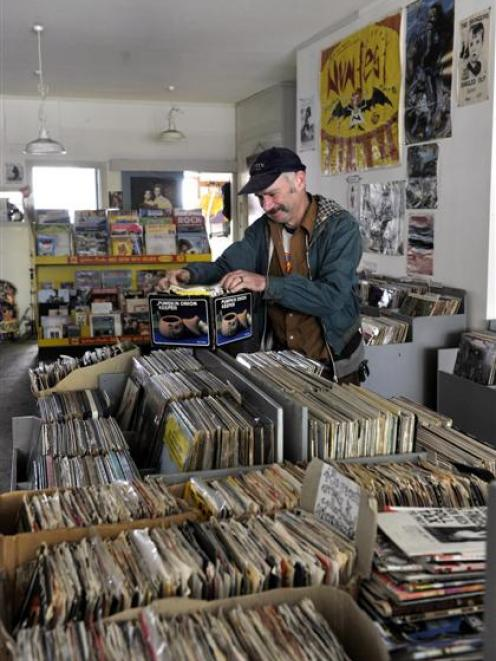 Records Records owner Patrick Faigan prepares his remaining stock yesterday for sale. The shop is...