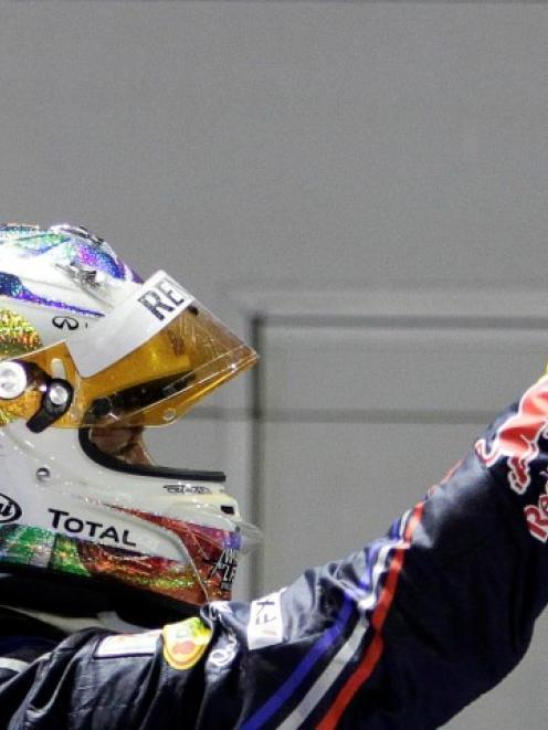 Red Bull Formula One driver Sebastian Vettel of Germany celebrates winning the Singapore Grand...