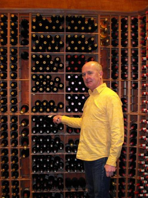 Rees Hotel chief executive Mark Rose holds a $4000 bottle of wine in the award-winning cellar...
