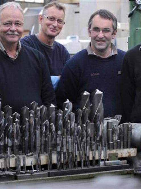 Reflecting on their long service at Dunedin engineering firm DC Ross Ltd, are (from left) chief...