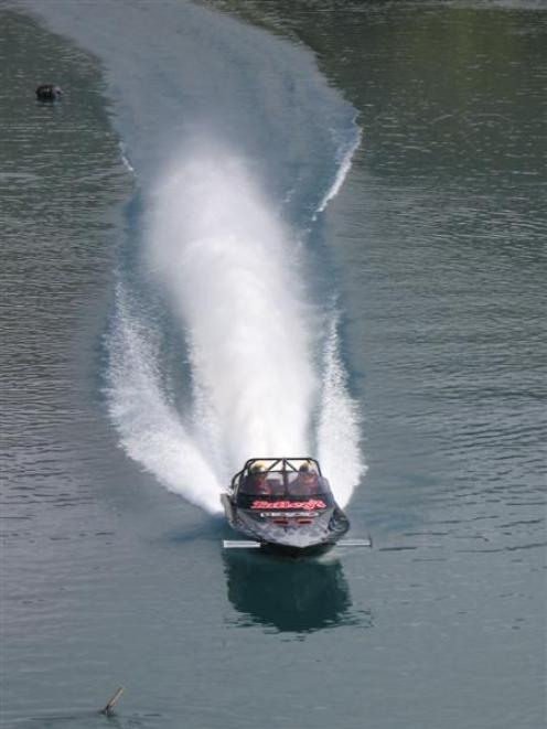 Regan Williamson and Peter Reid cross Frankton Arm, Lake Wakatipu, in their gas turbine jet-boat....