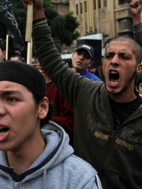 Relatives of Lebanese who had gone missing in Syria chant slogans during a protest to enquire...