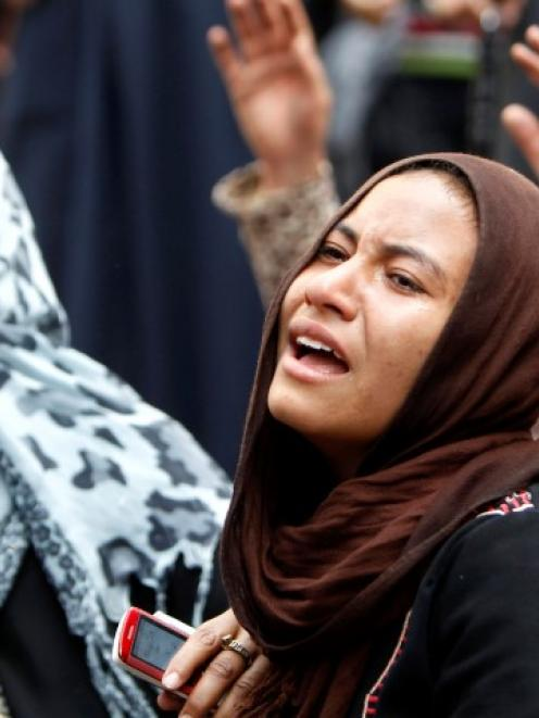 Relatives of Muslim Brotherhood members and supporters of ousted President Mohamed Mursi react...