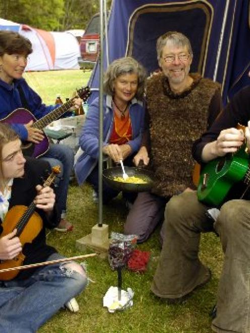 Relaxing outside their tent at last year's Whare Flat Folk Festival are (front, from right) Khris...