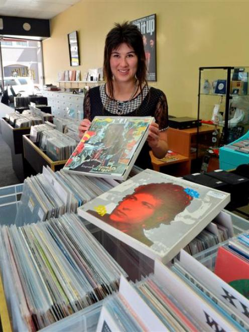 Relics music store assistant Sarah Williamson unpacks a collectable Bob Dylan album boxed set...