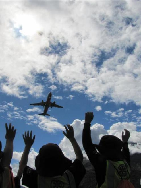 Remarkables Primary School pupils wave goodbye to a jet aircraft at Queenstown Airport yesterday.