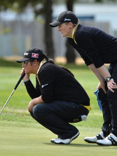 Renee Fowler (right) helps Barbara Parreno line up a putt during the women's interprovincial at...