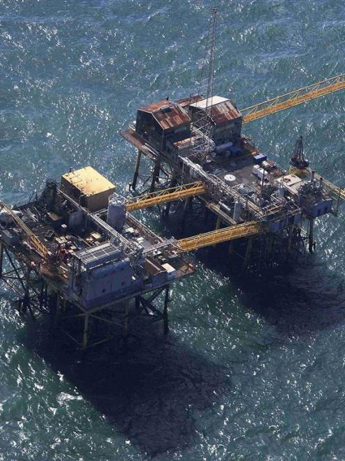 Rescue crew surrounds the stricken oil platform. REUTERS/Sean Gardner