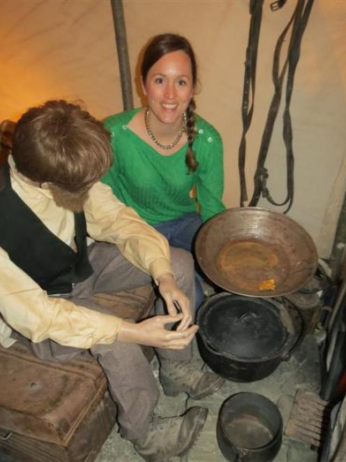 Researcher and curator Angela English, of Dipton, visits a gold prospector's hut, one of the...