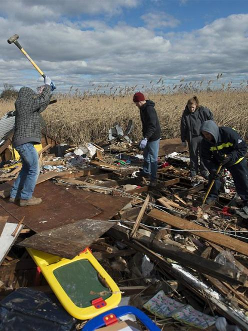 Residents dig through the debris left by Hurricane Sandy in the Staten Island Borough of New York...
