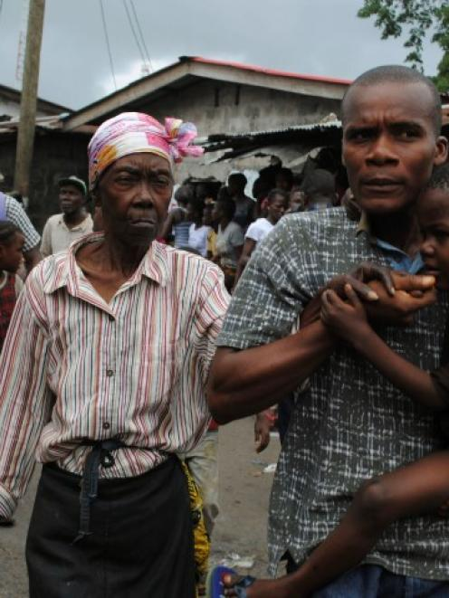 Residents flee during clashes in the West Point quarantined neighbourhood of Liberia's capital...