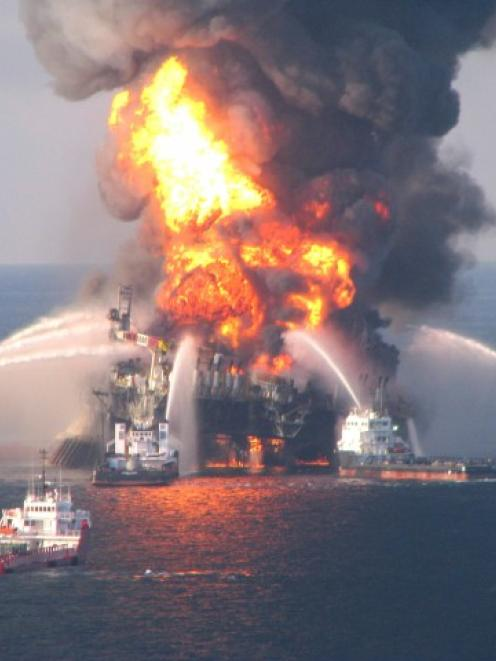 Response crews battle the blazing remnants of the off-shore oil rig Deepwater Horizon, off...