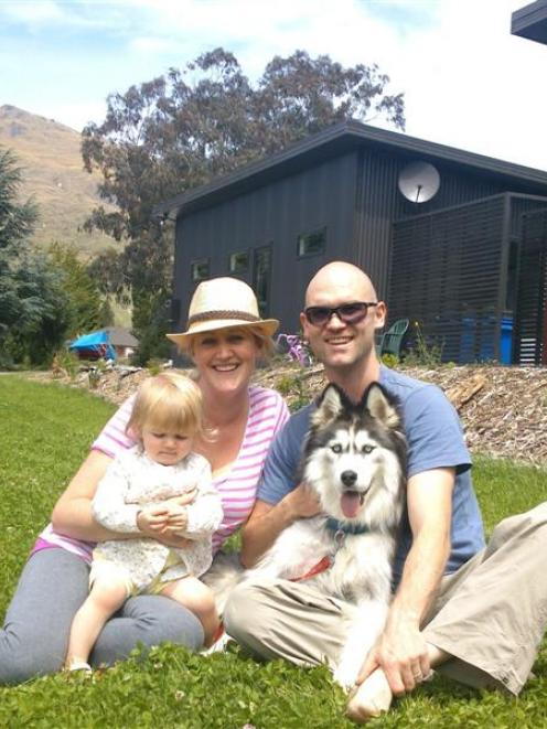 Reunited in Kingston yesterday with their dog Wolf are Ryan, Kirsteen and Willow (1) Watt. Photo...