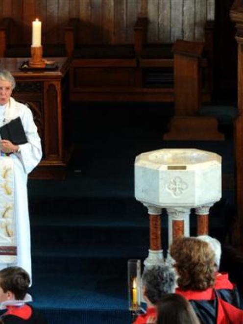 Rev Dr Sarah Mitchell sings the blessing at her last service at Knox Church yesterday. At right...