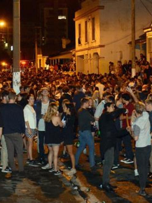 Revellers gather in Hyde St on Saturday night. Photo by Peter McIntosh.