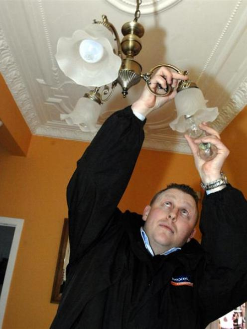 Rexel lighting specialist Chris Hartman replaces bulbs in the Luskie house. Photo by Linda Robertson  sc 1 st  Otago Daily Times & Light years on in savings | Otago Daily Times Online News