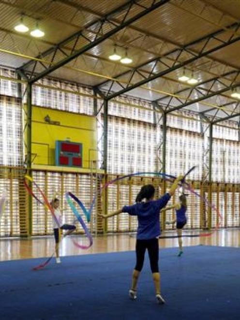 Rhythmic gymnasts train at the Caledonian Gymnasium on Andersons Bay Rd last week. Photo by Craig...