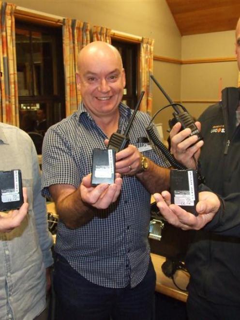 Richard Kennett (left), of Wakatipu LandSAR,  Queenstown Lions Club member Dan Turnbull (centre)...