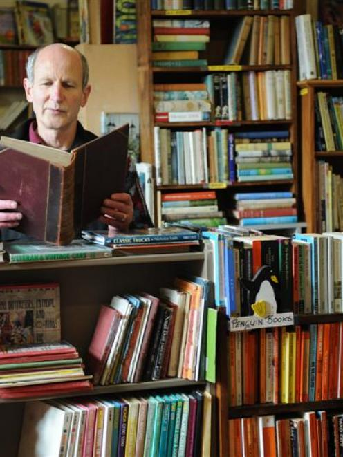 Richard McIntyre in his Octagon Books shop in Dunedin. Photo by Stephen Jaquiery.