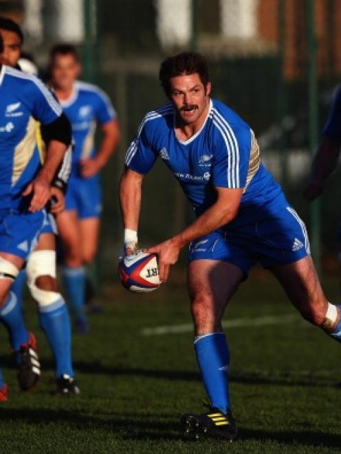 Richie McCaw of the All Blacks runs through drills during a training session at Latymers Upper...