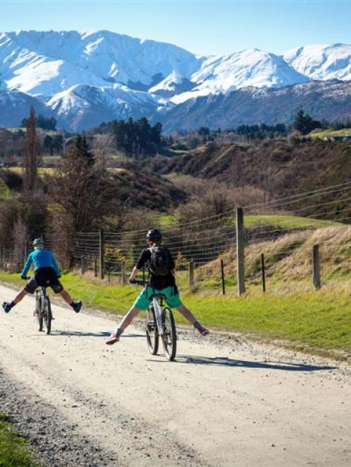 Riders approach Arrowtown on the Countryside Ride trail.